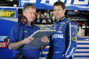 Carl Edwards (right), driver of the No. 99 Fastenal Ford, stands in the garage area beside his crew chief Bob Osborne during Daytona Preseason Thunder at Daytona International Speedway on Jan. 12 in Daytona Beach, Fla. - Photo Credit: Jared C. Tilton/Getty Images for NASCAR