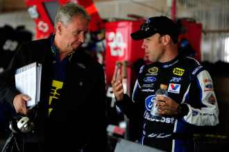 Matt Kenseth, right, driver of the No. 17 Ford EcoBoost Ford, talks with crew chief Jimmy Fennigin the garage during practice - Photo Credit: Robert Laberge/Getty Images for NASCAR