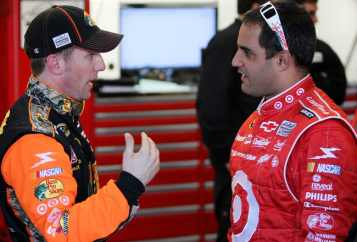 Earnhardt Ganassi Racing teammates Jamie McMurray &amp; Juan Pablo Montoya in garage - Photo Credit: Nick Laham/Getty Images for NASCAR