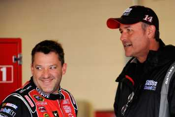 Tony Stewart, driver of the No. 14 Office Depot/Mobil 1 Chevrolet, talks with crew chief Steve Addington in the garage - Photo Credit: John Harrelson/Getty Images for NASCAR