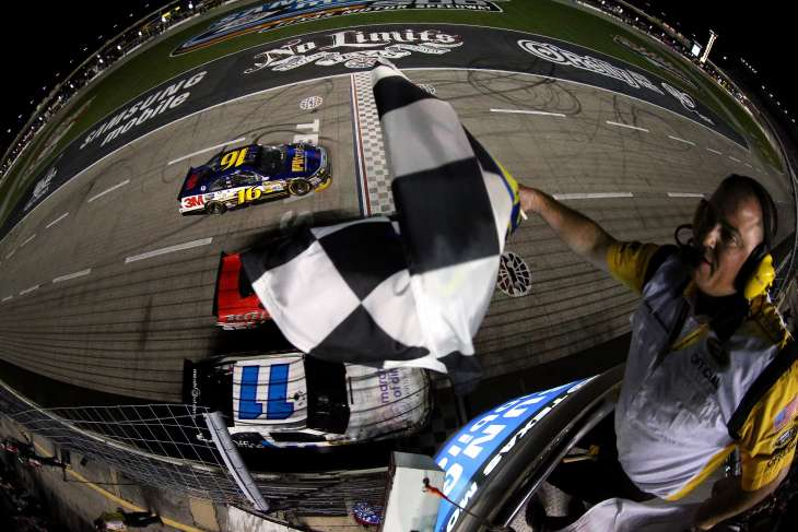 Greg Biffle, driver of the #16 Filtrete Ford, takes the checkered flag to win the NASCAR Sprint Cup Series Samsung Mobile 500 at Texas Motor Speedway on April 14, 2012 in Fort Worth, Texas.- Photo Credit: Chris Graythen/Getty Images