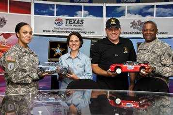 (Right to Left) U.S. Army Maj. Gen. Reuben D. Jones; Ryan Newman, driver of the U.S. Army's No. 39 NASCAR Sprint Cup Series Car; Ten80 Education president Terri Stripling; and U.S. Army Cpt. Marlene announced a new partnership between the U.S. Army and Ten80 Education focused on immersing students in real-life applications of STEM careers through teamwork and radio-controlled racecar competitions.(Photo Credit: Action Sports Photography)