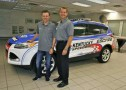 Two-time Daytona 500 champion Matt Kenseth and Louisville Assembly Plant Manager John Savona pose with the new 2013 Ford Escape pace vehicle for Kentucky Speedway&#039;s NASCAR weekend.