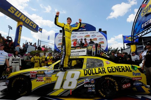 Joey Logano, driver of the #18 Dollar General Toyota, celebrates in Victory Lane after winning the NASCAR Nationwide Series 5-hour Energy 200 at Dover International Speedway on June 2, 2012 in Dover, Delaware. (Photo by Patrick McDermott/Getty Images for NASCAR)