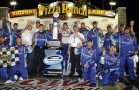 Elliott Sadler, driver of the #2 OneMain Financial Chevrolet, celebrates with his team in victory lane after winning the U.S. Cellular 250 race at Iowa Speedway on August 4, 2012 in Newton, Iowa. (Photo by Rainier Ehrhardt/Getty Images for NASCAR)