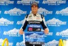 Nelson Piquet Jr., driver of the #30 AutoTrac Chevrolet, celebrates with the Keystone Light Pole Award after qualifying for the pole position for the NASCAR Camping World Truck Series Pocono Mountains 125 at Pocono Raceway on August 4, 2012 in Long Pond, Pennsylvania. (Photo by Jared C. Tilton/Getty Images)
