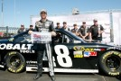 Jimmie Johnson, driver of the #48 Lowe's Kobalt Tools Chevrolet, poses with his pole award after he was the fastest driver during qualifying for the NASCAR Sprint Cup Series GEICO 400 at Chicagoland Speedway on September 15, 2012 in Joliet, Illinois. - Photo Credit: Tyler Barrick/Getty Images