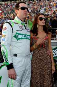 Kyle Busch, driver of the #18 Wrigley / Doublemint Toyota, stands on the grid with his wife Samanatha during the NASCAR Sprint Cup Series AdvoCare 500 at Atlanta Motor Speedway on September 2, 2012 in Hampton, Georgia. (Photo by John Harrelson/Getty Images)
