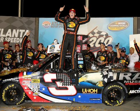 Ty Dillon, driver of the #3 Bass Pro Shops/Tracker Boats Chevrolet, celebrates with his crew in victory lane after he won the NASCAR Camping World Truck Series Jeff Foxworthy's Grit Chips 200 at Atlanta Motor Speedway on August 31, 2012 in Hampton, Georgia. (Photo by Tom Whitmore/Getty Images for NASCAR)