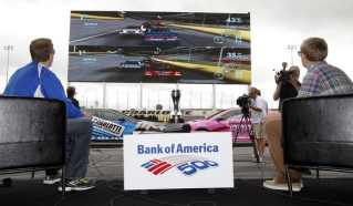 NASCAR Sprint Cup Series points leader Brad Keselowski faced off against Huntersville, N.C. resident Josh Bralley in an abbreviated Bank of America 500 on the world's largest HDTV. (CMS/HHP Photo)