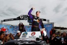 Denny Hamlin, driver of the #51 Toyota Toyota, celebrates in Victory Lane after winning the NASCAR Camping World Truck Series Kroger 200 at Martinsville Speedway on October 27, 2012 in Ridgeway, Virginia. - Photo Credit: Tyler Barrick/Getty Images