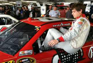 Landon Cassill Climbing into Car - BK Racing