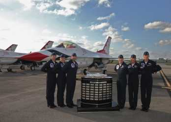 USAF Thunderbirds with the Harley J. Earl Perpetual Trophy taken on Thursday at Daytona Beach International Airport (Photo credit: Daytona International Speedway).