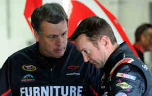 Kurt Busch, driver of the #78 Furniture Row/Farm American Chevrolet, talks to his crew chief Todd Berrier in the garage area - Photo Credit: John Harrelson/Getty Images