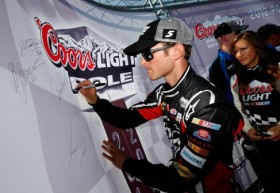 Kasey Kahne, driver of the #5 HendrickCars.com Chevrolet, signs the wall after qualifying for the pole position in the NASCAR Sprint Cup Series Good Sam Roadside Assistance 500 at Talladega Superspeedway on October 6, 2012 in Talladega, Alabama. (Photo by Tom Pennington/Getty Images)