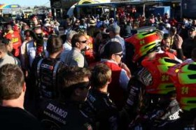Police break up fights in the garage area after an on-track incident with Clint Bowyer (not pictured), driver of the #15 5-hour Energy Toyota, and Jeff Gordon (not pictured), driver of the #24 DuPont Chevrolet, during the NASCAR Sprint Cup Series AdvoCare 500 at Phoenix International Raceway on November 11, 2012 in Avondale, Arizona. - Photo Credit: Tyler Barrick/Getty Images