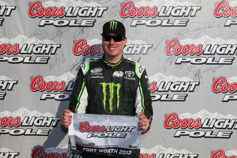 Kyle Busch, driver of the #54 Monster Energy Toyota, poses with the Coors Light Pole Award after qualifying on the pole position for the NASCAR Nationwide Series O'Reilly Auto Parts Challenge at Texas Motor Speedway on November 3, 2012 in Fort Worth, Texas. - Photo Credit:Tom Pennington/Getty Images