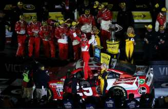 Kevin Harvick, driver of the #29 Budweiser Chevrolet, celebrates in victory lane after winning the NASCAR Sprint Cup Series Sprint Unlimited at Daytona International Speedway on February 16, 2013 in Daytona Beach, Florida. - Photo Credit: Matthew Stockman/Getty Images