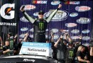 Kyle Busch, driver of the #54 Monster Energy Toyota, celebrates in victory lane after winning the NASCAR Nationwide Series Royal Purple 300 at Auto Club Speedway on March 23, 2013 in Fontana, California. (Photo by Chris Graythen/Getty Images)