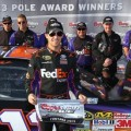 Denny Hamlin, driver of the #11 FedEx Express Toyota, poses after qualifying for the pole position in the NASCAR Sprint Cup Series Auto Club 400 at Auto Club Speedway on March 22, 2013 in Fontana, California. - Photo Credit: Jonathan Ferrey/Getty Images