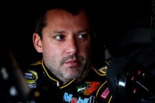 Tony Stewart, driver of the #14 Rush Truck Centers/Mobil 1 Chevrolet, sits in his car = Photo Credit: Jonathan Ferrey/Getty Images