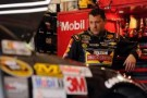 Tony Stewart, driver of the #14 Rush Truck Centers/Mobil 1 Chevrolet, stands in the garage area during practice for the NASCAR Sprint Cup Series Auto Club 400 at Auto Club Speedway on March 22, 2013 in Fontana, California. - Photo Credit: Jared C. Tilton/Getty Images