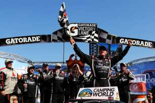 Johnny Sauter, driver of the #98 Carolina Nut Co./Curb Records Toyota, celebrates in Victory Lane after winning the NASCAR Camping World Truck Series Kroger 250 on April 6, 2013 at Martinsville Speedway in Ridgeway, Virginia. - Photo Credit: Jerry Markland/Getty Images