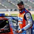 Eric McClure, driver of the #14 Hefty/Reynolds Toyota, stands on the grid - Photo Credit: Ronald Martinez/Getty Images