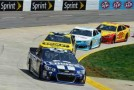 Jimmie Johnson, driver of the #48 Lowe&#039;s Chevrolet, leads Marcos Ambrose, driver of the #9 Stanley Ford, Brian Vickers, driver of the #55 Jet Edge Toyota, and Joey Logano, driver of the #22 Shell Pennzoil Ford, during the NASCAR Sprint Cup Series STP Gas Booster 500 on April 7, 2013 at Martinsville Speedway in Ridgeway, Virginia. - Photo Credit: Drew Hallowell/Getty Images