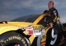 2013 NSCS Driver Marcos Ambrose Climb into the No. 9 DEWALT Ford Fusion - Photo Credit: Streeter Lecka/Getty Images