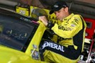 Matt Kenseth, driver of the #20 Dollar General Toyota, climbs into his car in the garage area - Photo Credit: Tom Pennington/Getty Images