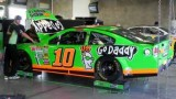 2013 NSCS No. 10 GoDaddy Chevrolet SS in the garage at Indianapolis Motor Speedway - Photo Credit: Paul Powell/Catchfence