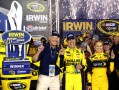 Matt Kenseth, driver of the #20 Dollar General Toyota, celebrates with the trophy in Victory Lane after winning the NASCAR Sprint Cup Series 53rd Annual IRWIN Tools Night Race at Bristol Motor Speedway on August 24, 2013 in Bristol, Tennessee. - Photo Credit: Jerry Markland/Getty Images