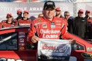 Ryan Newman, driver of the #39 Quicken Loans Chevrolet, poses in Victory Lane after qualifying for the pole position in the NASCAR Sprint Cup Series Sylvania 300 at New Hampshire Motor Speedway on September 20, 2013 in Loudon, New Hampshire. - Photo Credit: Patrick Smith/Getty Images