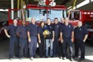 Kurt Busch with members of the Kansas City Fire Department - Photo Credit: NASCAR via Getty Images
