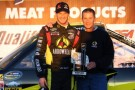 Jeb Burton, driver of the #4 Arrowhead / Kangaroo Express Dodge, celebrates with Ward Burton after setting the pole position in qualifying for the Camping World Truck Series Fred's 250 at Talladega Superspeedway on October 18, 2013 in Talladega, Alabama. - Photo Credit: Jonathan Ferrey/Getty Images