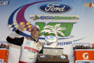 Brad Keselowski, driver of the #48 Discount Tire Ford, poses with the trophy after winning the NASCAR Nationwide Series Ford EcoBoost 300 at Homestead-Miami Speedway on November 16, 2013 in Homestead, Florida. - Photo Credit: Todd Warshaw/Getty Images