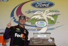 Denny Hamlin, driver of the #11 FedEx Express Toyota, poses with the winner's trophy after winning the NASCAR Sprint Cup Series Ford EcoBoost 400 at Homestead-Miami Speedway on November 17, 2013 in Homestead, Florida. - Photo Credit: Getty Images for NASCAR