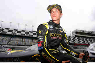 Dylan Kwasniewski, driver of the #31 Rockstar/FOE Chevrolet, sits on pit wall during qualifying for the NASCAR Nationwide Series DRIVE4COPD 300 at Daytona International Speedway on February 21, 2014 in Daytona Beach, Florida. - Photo Credit: Brian Lawdermilk/Getty Images