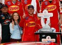 Regan Smith, driver of the #7 Ragu Chevrolet, celebrates in Victory Lane with his wife Megan Mayhew after winning the NASCAR Nationwide Series DRIVE4COPD 300 at Daytona International Speedway on February 22, 2014 in Daytona Beach, Florida. - Photo Credit: Tom Pennington/Getty Images