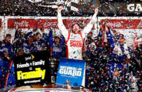Dale Earnhardt Jr., driver of the #88 National Guard Chevrolet, celebrates in Victory Lane after winning the NASCAR Sprint Cup Series Daytona 500 at Daytona International Speedway on February 23, 2014 in Daytona Beach, Florida. - Photo Credit: Tom Pennington/Getty Images