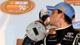 Daniel Suarez kisses the trophy after winning the NASCAR K&N Pro Series East portion of the UNOH Battle At The Beach Tuesday night at Daytona International Speedway (Photo Credit: Getty Images)