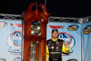Matt Crafton, driver of the #88 Ideal Doors / Menards Toyota, poses in Victory Lane with the trophy after winning the NASCAR Camping World Truck Series Kroger 250 at Martinsville Speedway on March 30, 2014 in Martinsville, Virginia. - Photo Credit: Jeff Zelevansky/Getty Images