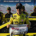 Matt Kenseth, driver of the #20 Dollar General Toyota, celebrates setting the pole position in qualifying for the NASCAR Sprint Cup Series Auto Club 400 at Auto Club Speedway on March 21, 2014 in Fontana, California.- Photo Credit: Todd Warshaw/Getty Images