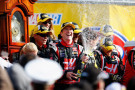 Kurt Busch, driver of the #41 Haas Automation Chevrolet, celebrates in victory lane with champagne after winning during the NASCAR Sprint Cup Series STP 500 at Martinsville Speedway on March 30, 2014 in Martinsville, Virginia. - Photo Credit: Matt Sullivan/Getty Images