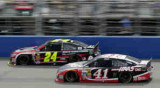 Kurt Busch, driver of the #41 Haas Automation Chevrolet, and Jeff Gordon, driver of the #24 Drive To End Hunger Chevrolet, race during the NASCAR Sprint Cup Series Auto Club 400 at Auto Club Speedway on March 23, 2014 in Fontana, California. - Photo Credit: Jerry Markland/Getty Images