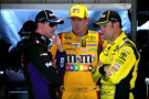 (L-R) Denny Hamlin, driver of the #11 FedEx Freight Toyota, Kyle Busch, driver of the #18 M&M's Toyota, and Matt Kenseth, driver of the #20 Dollar General Toyota, talk in the garage area during practice for the NASCAR Sprint Cup Series STP 500 at Martinsville Speedway on March 28, 2014 in Martinsville, Virginia. - Photo Credit: Jeff Curry/Getty Images