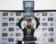Kyle Busch, driver of the #54 Monster Energy Toyota, celebrates in Victory Lane with the trophy after winning the NASCAR Nationwide Series Blue Jeans Go Green 200 at Phoenix International Raceway on March 1, 2014 in Avondale, Arizona. - Photo Credit: Jeff Zelevansky/Getty Images