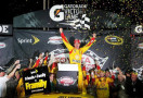 Joey Logano, driver of the #22 Shell-Pennzoil Ford, celebrates in Victory Lane after winning the NASCAR Sprint Cup Series Toyota Owners 400 at Richmond International Raceway on April 26, 2014 in Richmond, Virginia. - Photo Credit: Todd Warshaw/Getty Images