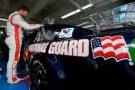 Dale Earnhardt Jr., driver of the #88 National Guard/Superman Chevrolet, stands in the garage area during practice for the NASCAR Sprint Cup Series Coca-Cola 600 at Charlotte Motor Speedway on May 22, 2014 in Charlotte, North Carolina. - Photo Credit: Jared C. Tilton/Getty Images